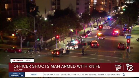 Officer shoots man armed with knife