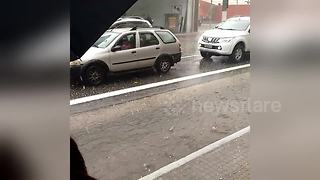 Commuters take shelter from Sao Paulo hailstorm - Video
