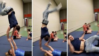 Hilarious handstand faceplant: Duo handstand goes horribly wrong - Video