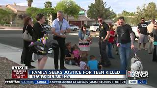 Police hold community event after teen is shot and killed - Video