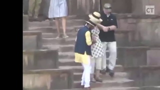 Hillary Looks Like Ragdoll as Legs Give Out on Stairs - Video