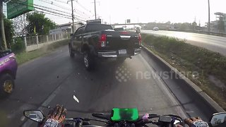 Dashcam shows moment motorcyclist smacks into rear of pickup truck