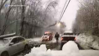 Tree limb falls on power lines over car accident - Video