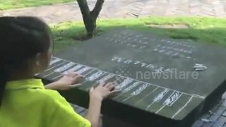 Girl practices piano on table with chalked keyboard - Video