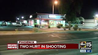 Two men shot outside Phoenix fast food restaurant - Video