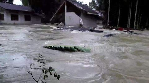 Father watches as flash flood destroys house