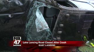 Pickup truck hits vehicle, power pole before rolling on side - Video