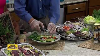 Little Greek restaurant owner whips up summer salad on the go - Video