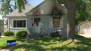 Family escapes fire started by child playing with lighter - Video