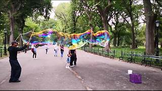 Slow motion footage of bubble man in Central Park, NY