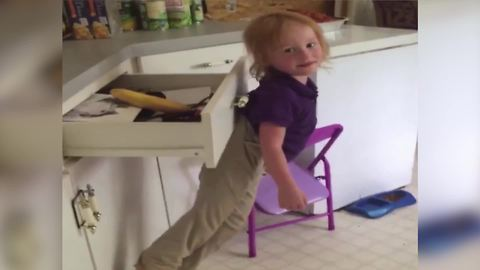 Tot Boy Gets Stuck On A Drawer Handle