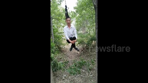 Chinese man uses own hair as 'rope swing'