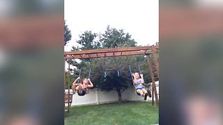 A Young Girl Falls Off Instead Of Jumping Off A Swing - Video
