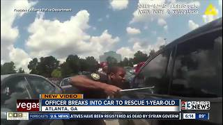 Atlanta police officer breaks window to reach child - Video