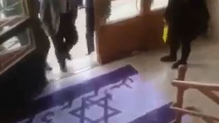 Iranian Professor Refuses to Step on Israeli or American Flags - Video
