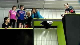 Thuy Lan Nguyen tries the spider wall at 'Ninja Warrior' gym - Video