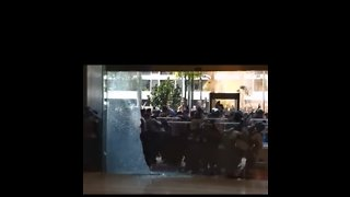 Protesters in Jakarta Smash Window at Ride-Hail App's Office