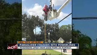 Paraglider crashes into power lines causing electric burns, power outage - Video