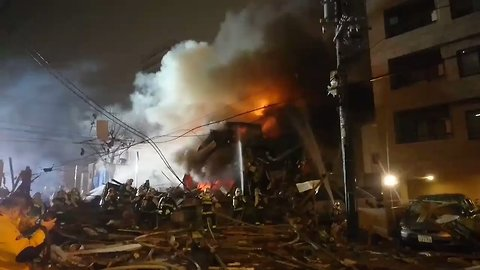 Firefighters Spray Water on Flaming Wreckage Following Sapporo Explosion