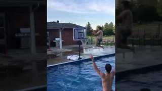 Friends Play Epic Slam-Dunk Game in Swimming Pool