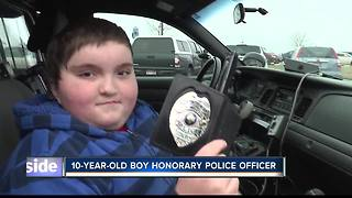 Nampa child gets his Christmas wish to be a police officer - Video