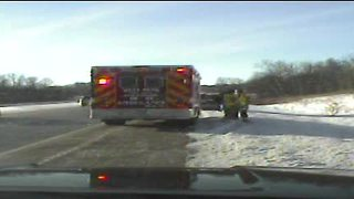 Distracted driver nearly slams into West Bend ambulance - Video
