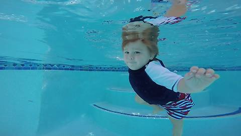 1-year-old boy is already an expert swimmer