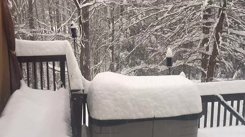 Time lapse shows snowfall in backyard of West Virginia home