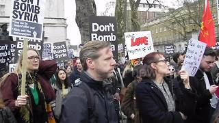 Protesters chant 'Don't bomb Syria!' outside Downing Street - Video