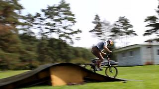 Dude pulls off insane backwards bike flip
