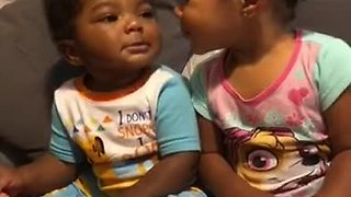 Baby siblings preciously show affection toward one another