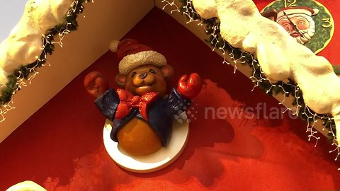 That'll frighten the elves! Christmas bear appears to make VERY rude hand gesture at LA grotto