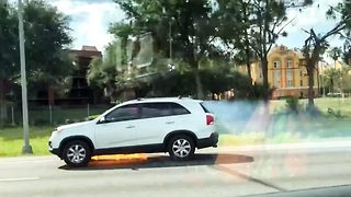 Woman captures shocking moment Kia drives down Interstate with sparks flying from underneath before bursting into flames - Video