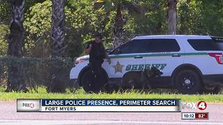 Large police presence conducts manhunt along Colonial Boulevard in Fort Myers - Video
