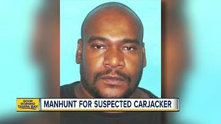 'Armed and extremely dangerous': Deputies search for armed carjacking suspect - Video