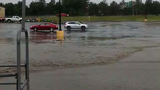 Parking Lots, Streets Under Water After Inches of Rain in Utica - Video