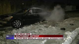 Water main break trapping cars in southwest Detroit - Video