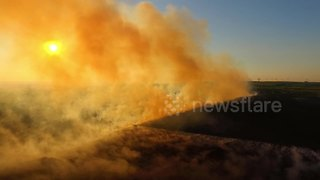 Drone captures eerie sight of Northern Ireland wildfire during sunset - Video