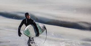 Surfers try to ride frozen waves in Massachusetts