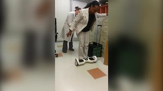 A Woman Struggles To Stand On A Self-Balancing Scooter - Video