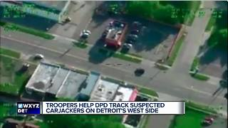 Michigan State Police helicopter busts carjacking suspects - Video