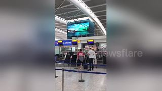 Heathrow showing spirit as last flight to Moscow departs - Video