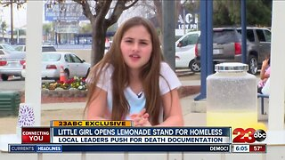 Little girl supports the homeless