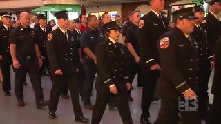 Firefighters remember 9/11 in march down Fremont Street - Video