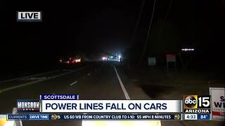 Downed power lines trap drivers in Scottsdale - Video