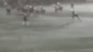 High School Varsity Teams Continue Playing Football Despite Fierce Weather Conditions - Video