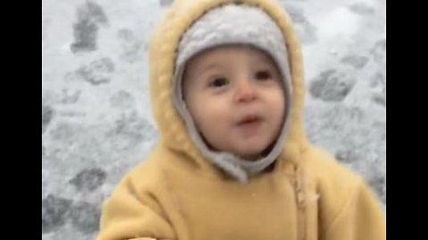 This Kid Was Amazed and Intrigued by His First Encounter With Snow