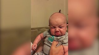 Cute Baby Makes A Face When His Dad Kisses Him - Video