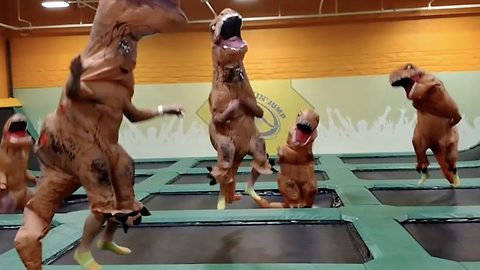 Adrenaline junkies turn trampoline park into Jurrasic park with hilarious T-Rex costume takeover