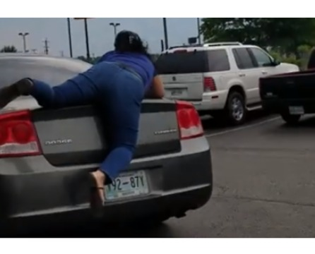 Public Argument Leads to Woman Riding on Top of Fleeing Car